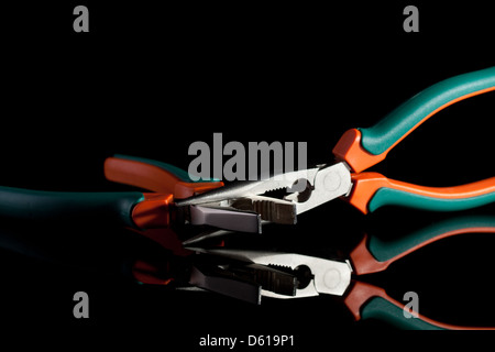 locked flat and needle nose pliers - Stock Photo