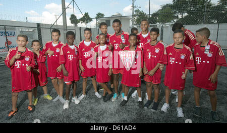 Children dressed in their new jerseys of FC Bayern Muinich, which they received from former professional soccer - Stock Photo