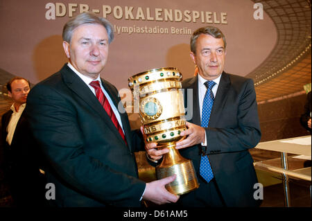Governing mayor of Berlin, Klaus Wowereit (L) receives the DFB-Cup from President of the German Football Association - Stock Photo