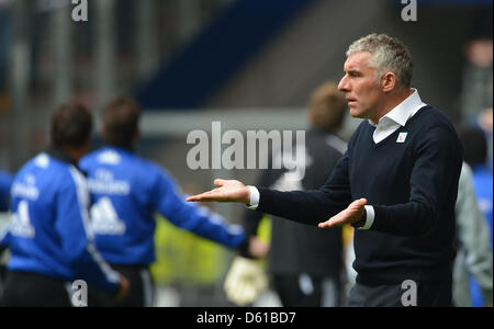 Hannover's head coach Mirko Slomka gestures during the Bundesliga soccer match between Hamburger SV and Hannover - Stock Photo