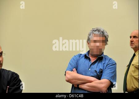The 51 year old defendant Thomas S. stands in the court room of the Regional Court Munich II in Munich, Germany, - Stock Photo