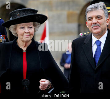 Dutch Queen Beatrix (L) welcomes Turkish President Abdullah Gul at the Royal Palace in Amsterdam, the Netherlands - Stock Photo