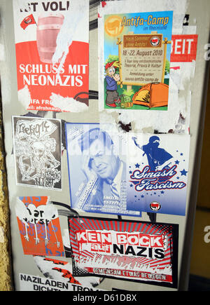 Antifacist stickers are stuck in the stairwell at the Antifacist Press Archive and Education Center Berlin e.V., - Stock Photo