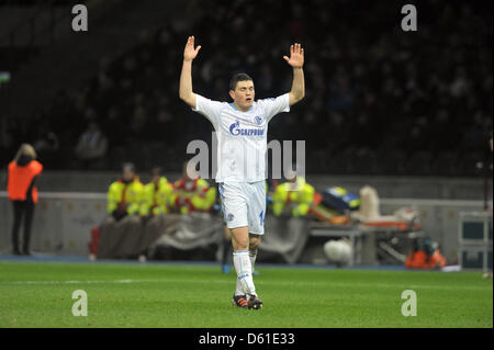 FILE - A file photo dated 09 December 2011 shows Schalke's Kyriakos Papadopoulos raising his arms during the German Bundesliga soccer match between Hertha BSC and FC Schalke 04 at the Olympic Stadium in Berlin, Germany. Photo: Oliver Mehlis
