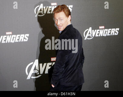 British actor Tom Hiddleston poses for the camera during the 'Marvel's the Avengers' photocall in Berlin, Germany, - Stock Photo