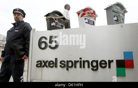 Protesters have placed chained letter boxes in front of the headquarters of media group Axel Springer AG in Berlin, - Stock Photo