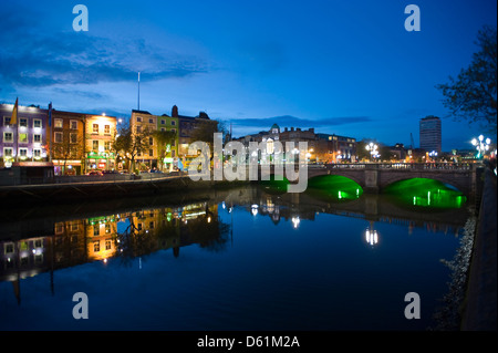 Horizontal downstream view of the O'Connell Bridge or Droichead Uí Chonaill crossing the River Liffey in Dublin - Stock Photo