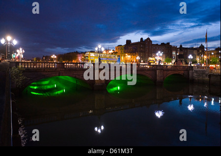 Horizontal upstream view of the O'Connell Bridge or Droichead Uí Chonaill crossing the River Liffey in Dublin at - Stock Photo
