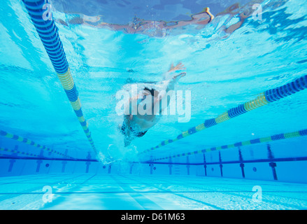 Underwater shot of young male thlete swimming in pool - Stock Photo