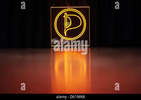 (dpa FILE) - An archive picture, dated 3 December 2011, shows the illuminated logo of the Pirate Party in the guildhall - Stock Photo