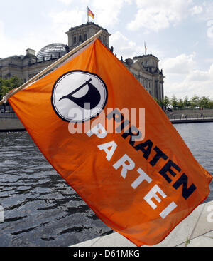 (dpa FILE) - An archive picture, dated 7 August 2009, shows the püarty flag of the PIrate Party swaying in the wind - Stock Photo