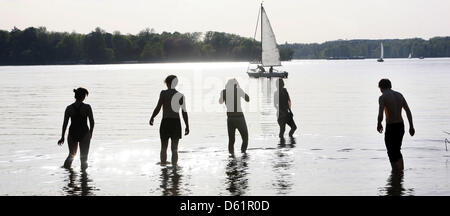 Young people make first careful steps into the Wannsee lake in Berlin, Germany, 28 April 2012. Photo: Stephanie - Stock Photo