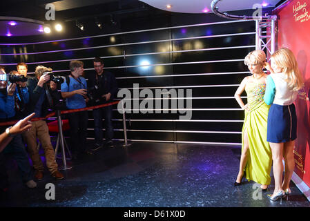TV personality and model Sylvie van der Vaart (R) presents her wax likeness at Madame Tussaud's in Berlin, Germany, - Stock Photo