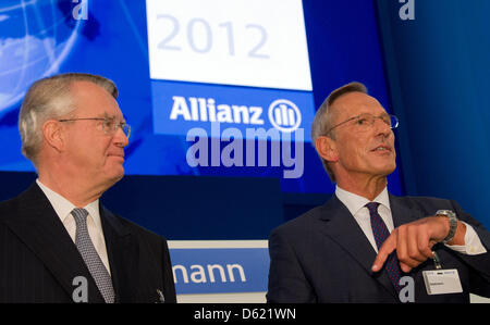 Chairman of the board of Allianz SE Henning Schulte-Noelle (L) and CEO od ALiianz SE Michael Diekmann stand in front of an animated picture of the globe at the general meeting of shareholders at the Olympic Hall in Munich, Germany, 09 May 2012. After a rather bad last year, Allianz can report a good start for 2012. Photo: PETER KNEFFEL