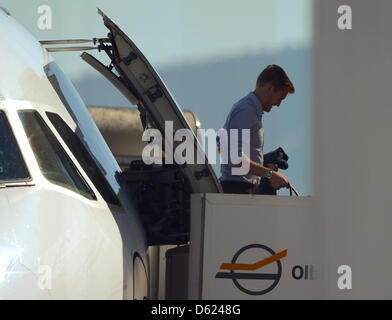 Germany's Andre Schuerrle leaves the plane after arriving at the airport on the Italian island of Sardinia in Olbia, - Stock Photo