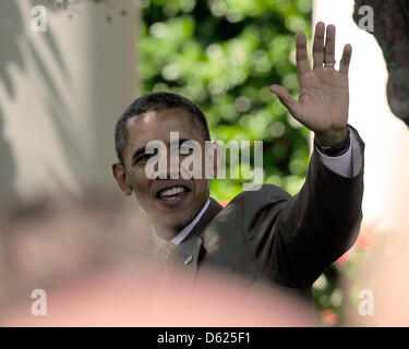 United States President Barack Obama waves farewell after he and U.S. Vice President Joe Biden honored the 2012 - Stock Photo