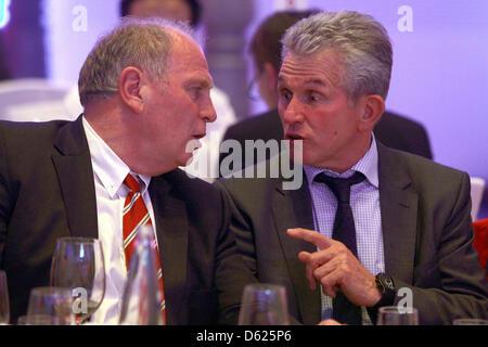 BERLIN, GERMANY - MAY 13: Uli Hoeness (L), President of Bayern Muenchen, talks to head coach Jupp Heynckes during - Stock Photo