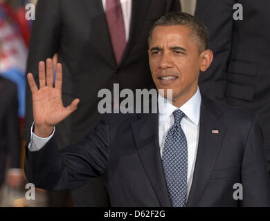 US President Barack Obama waves to the journalists during the family photo at the 2012 NATO Summit group dinner - Stock Photo