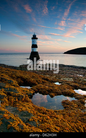Dawn at Penmon Lighthouse, Anglesey West Wales UK - Stock Photo