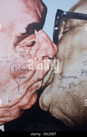 A detail from the oversized artwork entitled Brotherhood Kiss (Bruderkuss) by Dmitry Vrubel that once adorned a - Stock Photo