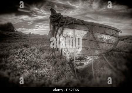 Old wooden boat on saltmarshes at Burnham Deepdale near Brancaster Staithe in Norfolk, England UK - Stock Photo
