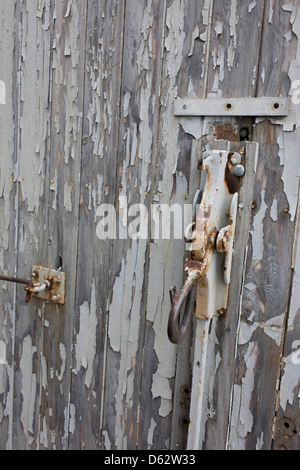 Peeled paint and security at the entrance of the notorious secret police (Stasi) Hohenschonhausen prison. The Berlin - Stock Photo