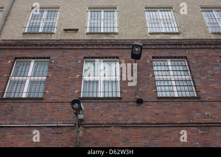 CCTV cameras and barred windows and architecture of the notorious secret police (Stasi) Hohenschonhausen prison. - Stock Photo