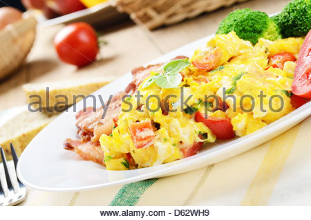 Omelette with vegetables and fried bacon - Stock Photo