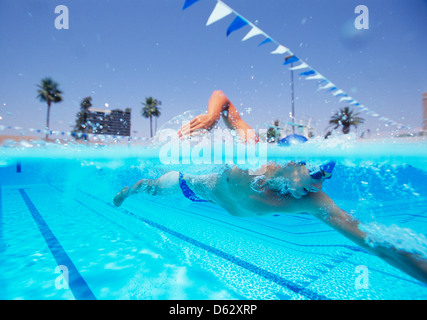 Young male thlete swimming in pool - Stock Photo