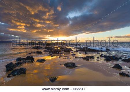 Sunset on Kama'ole Beach 3 on the island of Maui in the State of Hawaii USA - Stock Photo