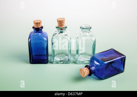 Colored mini glass bottles with cork tops - Stock Photo