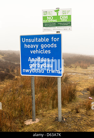 Sign on remote road unsuitable for heavy goods vehicles and no tipping in Welsh and English, Blorenge mountain, - Stock Photo