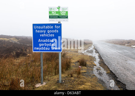 Sign on remote road unsuitable for heavy goods vehicles and no fly tipping in Welsh and English, Blorenge mountain, - Stock Photo