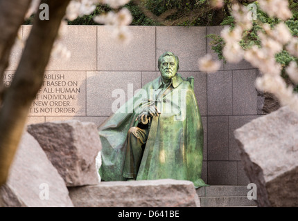 Early blurred Japanese cherry blossoms surround the memorial to President Franklin Delano Roosevelt in Washington - Stock Photo