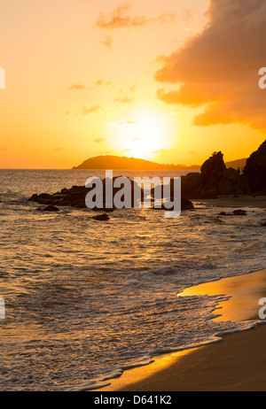 Sun setting over islands by Charlotte Amalie in St Thomas taken from Frenchmans Bay - Stock Photo