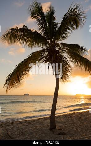 Cruise ship leaves Charlotte Amalie at sunset past Frenchmans bay on St Thomas USVI - Stock Photo