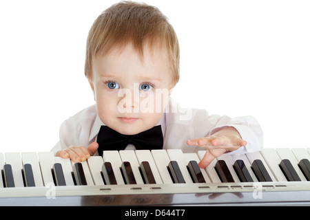 adorable child playing electronic piano - Stock Photo