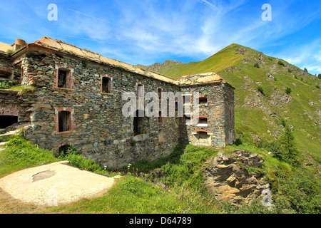 Old abandoned military fortress in Alps, Northern Italy. - Stock Photo