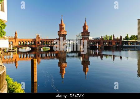 oberbaum bridge over spree river in berlin, germany - Stock Photo