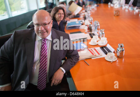 German Minister of the Environment Peter Altmaier (CDU) awaits the start of the cabinet meeting at the Federal Chancellery - Stock Photo