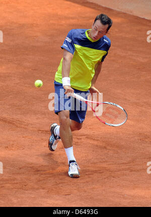 German tennis pro Philipp Kohlschreiber serves the ball against Croatia's Zovko during the Tennis World Team Cup - Stock Photo