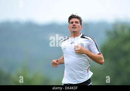 Germany's Mario Gomez warms up during practice on a pitch in Tourettes, France, 29 May 2012. The German national - Stock Photo