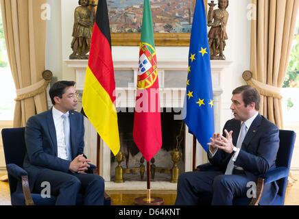 German Minister of Economics Philipp Roesler (L) and Prime Minister of Portugal Pedro Passos Coelho talk in Lisbon, - Stock Photo