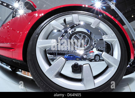 Different car models of car manufacturer VW are relfected in a hub cap at the VW exhibition booth at the Auto Mobil - Stock Photo