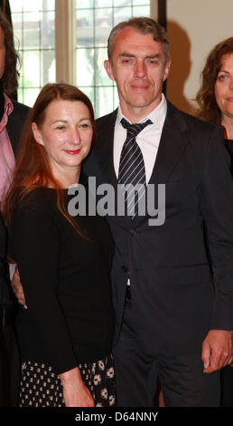 German artist Neo Rauch stands together with his wife Rosa Loy during the festive opening of the graphics foundation - Stock Photo
