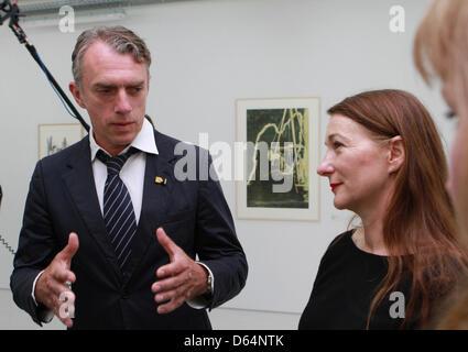 German artist Neo Rauch and his wife Rosa Loy (R) walk through the exhibition 'Neo Rauch. Das grafische Werk - Erster - Stock Photo