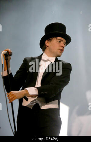 Swedish singer 'Howlin' Pelle Almqvist and band 'The Hives' perform on the first evening of three-day-festival Rock - Stock Photo