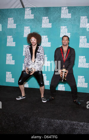 Musicians Red Foo (l) and Sky Blu of 'LMFAO' pose in the press room of the 2012 MTV Movie Awards at Gibson Amphitheatre - Stock Photo