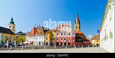 panorama with colorful houses on small square in sibiu, transylvania, romania - Stock Photo