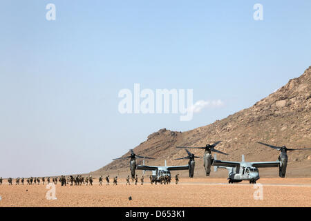 US Marine Corps MV-22B Osprey aircraft with Marine Medium Tiltrotor Squadron 264 board a joint military operation - Stock Photo